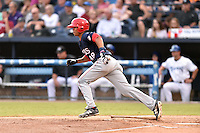 Hagerstown Suns center fielder Blake Perkins (48) runs to first base during a game against the  Asheville Tourists at McCormick Field on September 4, 2016 in Asheville, North Carolina. The Suns defeated the Tourists 10-5. (Tony Farlow/Four Seam Images)