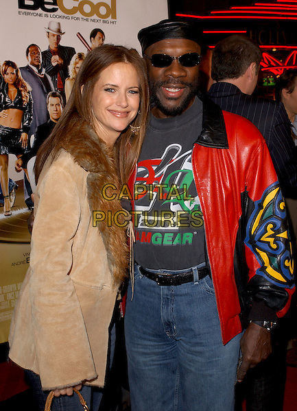 "KELLY PRESTON & ISAAC HAYES.Attends MGM's World Premiere of ""Be Cool"" held at The Grauman's Chinese Theatre in Hollywood, California, USA, February 14th 2005.half length.Ref: DVS.www.capitalpictures.com.sales@capitalpictures.com.©Capital Pictures."