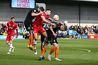 Andrew Boyce of Grimsby Town (centre) battles for the ball during the Sky Bet League 2 match between Barnet and Grimsby Town at The Hive, London, England on 29 April 2017. Photo by David Horn.
