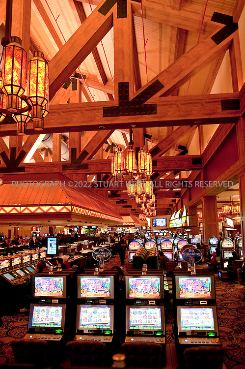 "5/7/2009--Snoqualmie, WA, USA.NOTE: FACES HAVE BEEN DIGITALLY BLURRED TO PROTECT IDENTITY.The new Snoqualmie Casino. Tribal casinos around Washington State generated some $1.34 billion in combined revenue in 2007, up eight-fold in just a decade. Tribes were using this influx of cash to build state-of-the-art health care facilities, fund college tuitions and even put money directly in the pockets of their members. ..After suffering through decades of dispossession and abject poverty, the Snoqualmies weren't interested in struggling to just make ends meet any longer (in 2001, a demographic survey revealed unemployment at 42 percent; it dropped to 31 percent in 2006). To tribal administrator Matt Mattson, casino gambling was the only option that offered ""the opportunity to restore the tribe to its rightful position of prominence in the land that's named after it.""..The Snoqualmies--who once dominated Western Washington, controlling the all-important trade route through the Cascades to the sea-- wasn't even recognized by the federal government and had no reservation or land of its own. Their quest for government recognition took decades--years in which they pieced together enough evidence of cohesion to convince the U.S. Bureau of Indian Affairs (BIA) to recognize them as a ""domestic sovereign nation"" under federal law--a designation they had lost in 1952 (see sidebar). When they were finally granted this status in 1999, the tribe embarked on a quest to makes its dreams--a reservation that tribal members could call home, world-class health care for Snoqualmies and other Northwest natives, and access to as much education as any individual tribal members would want to pursue--come true...©2009 Stuart Isett. All rights reserved."