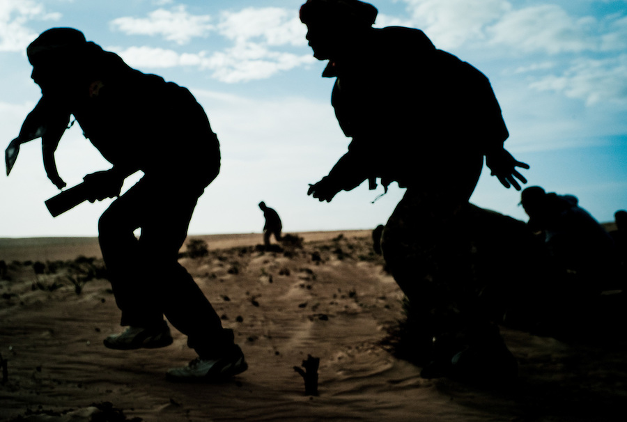 Rebel fighters on a recon mission in desert outside of Ajdabiya, Libya.