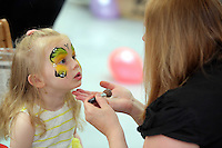 Isabelle Lewis has her face painted