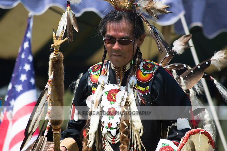 A Native American man in full traditional regalia dances at the 8th Annual Red Wing PowWow in Red Wing Park, Virginia Beach, Virginia.