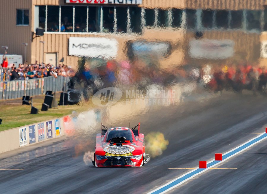 Jul 22, 2017; Morrison, CO, USA; NHRA funny car driver Jonnie Lindberg during qualifying for the Mile High Nationals at Bandimere Speedway. Mandatory Credit: Mark J. Rebilas-USA TODAY Sports