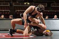 STANFORD, CA - January 18, 2015: Jim Wilson of the Stanford Cardinal wrestling team competes during a meet against Cal Poly at Maples Pavilion. Stanford won 22-13.