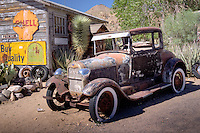 Hackberry Arizona, on route 66.  The mother lode of Mother Road memorabilia, inside and out, is the Hackberry General Store/museum. There are vintage gas pumps out front (but there is no gas). Mobilgas' Pegasus leaps from the roof, and the Greyhound dog welcomes bus travelers. Inside, visitors can walk through a vintage diner and have a bottle of Route 66 Root Beer. Virtually every trinket bearing the Route 66 theme, from neon to key chains, is in the store, and the guest book holds signatures from around the world.