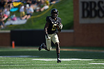 Arkeem Byrd (5) of the Wake Forest Demon Deacons breaks free for a 59-yard touchdown run during second quarter action against the Utah State Aggies at BB&T Field on September 16, 2017 in Winston-Salem, North Carolina.  (Brian Westerholt/Sports On Film)