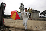A Naua Indian boy plays with a paper-made balloon in front of the church of the village of Ayotzinapan, Puebla. Photo by Heriberto Rodriguez/ CGEIB