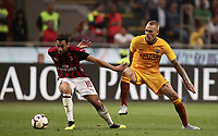 Calcio, Serie A: AC Milan - AS Roma, Milano stadio Giuseppe Meazza (San Siro) 31 agosto 2018. <br /> AC Milan's Hakan Calhanoglu (l) in action with AS Roma's Rick Karsdorp (r) during the Italian Serie A football match between Milan and Roma at Giuseppe Meazza stadium, August 31, 2018. <br /> UPDATE IMAGES PRESS/Isabella Bonotto
