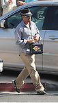 AbilityFilms@yahoo.com.805-427-3519.www.AbilityFilms.com..5-25-09.. Robert Downey Jr Carrying his Iron Man pelican case ( what is in there?) he takes everywhere. Leaving the Joel Silver Memorial Day Party in Malibu.