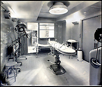 BNPS.co.uk (01202 558833)<br /> Pic:    CanterburyAuctionGalleries/BNPS<br /> <br /> The hospital, complete with operating table.<br /> <br /> Remarkable photos of the iconic ocean liner SS Normandie which was like a 'floating palace' have come to light over 80 years later.<br /> <br /> The giant 1,000ft long French passenger ship was the largest of her type in the world and won the coveted 'Blue Riband' for the fastest crossing of the Atlantic.<br /> <br /> English photographer Percy Byron's photos show the liner's luxurious 'Art Deco' interior with its chandeliers and pillars of Lalique glass.<br /> <br /> The vessel, which launched in 1935, even boasted its own swimming pool and a gym where young women can be seen doing aerobics while a man in a suit trains with a punch bag.