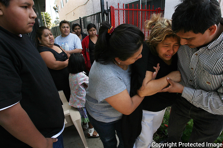 "Maria Perez, mother of shooting victim Antonio Carachurit, 17, is assisted leaving the scene of the shooting in Oceanside, California, in March, 2012. ""She has been crying all night,"" said one of the victim's cousins.  for the North County Times."