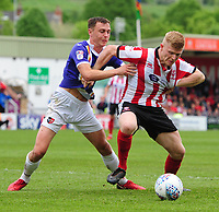 Lincoln City's Elliott Whitehouse shields the ball from Exeter City's Jordan Tillson<br /> <br /> Photographer Chris Vaughan/CameraSport<br /> <br /> The EFL Sky Bet League Two Play Off First Leg - Lincoln City v Exeter City - Saturday 12th May 2018 - Sincil Bank - Lincoln<br /> <br /> World Copyright &copy; 2018 CameraSport. All rights reserved. 43 Linden Ave. Countesthorpe. Leicester. England. LE8 5PG - Tel: +44 (0) 116 277 4147 - admin@camerasport.com - www.camerasport.com