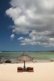 MAURITIUS, Chemin Grenier, South Coast, beach chairs and an umbrella await guests at Hotel Shanti Maurice, the Indian Ocean in the distance