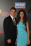 Alicia Minshew & Hubby Richie at the 38th Annual Daytime Entertainment Emmy Awards 2011 held on June 19, 2011 at the Las Vegas Hilton, Las Vegas, Nevada. (Photo by Sue Coflin/Max Photos)