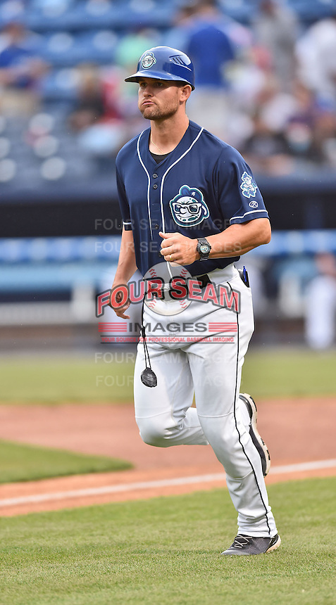 Asheville Tourists manager Warren Schaeffer (13) during game one of a double header against the Greenville Drive on April 18, 2015 in Asheville, North Carolina. The Tourists defeated the Drive 2-1. (Tony Farlow/Four Seam Images)