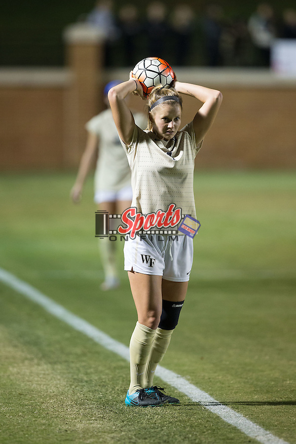 Megan Curan (4) of the Wake Forest Demon Deacons throws the ball in from the sideline during first half action against the Louisville Cardinals at Spry Soccer Stadium on October 31, 2015 in Winston-Salem, North Carolina.  The Demon Deacons defeated the Cardinals 2-1.  (Brian Westerholt/Sports On Film)