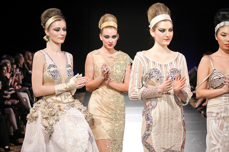 Models pose on runway in an outfits from the Haya Al Houti Fall 2011 collection, during Couture Fashion Week Fall 2011 in New York.