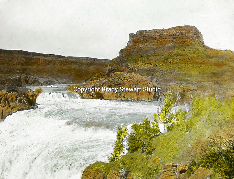 Twin Falls ID:  On the brink of the Shoshone Falls - 1910.  Brady Stewart and three friends went to Idaho on a lark from 1909 thru early 1912.  As part of the Mondell Homestead Act, they received a grant of 160 acres north of the Snake River.  Brady Stewart photographed the adventures of farming along with the spectacular landscapes. To give family and friends a better feel for the adventure, he hand-color black and white negatives into full-color 3x4 lantern slides.  The Process:  He contacted a negative with another negative to create a positive slide.  He then selected a fine brush and colors and meticulously created full color slides.