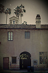 A small bell tower in the courtyard of the Mission Basilica San Juan Capistrano in Adobe style.