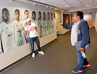 Pictured: Jefferson Montero of Swansea City FC shows off his giant picture to his manager at the tunnel of the Liberty Stadium, south Wales. UK Thursday 27 August 2015