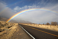 Rainbow on highway near Cedarville. Nevada