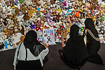 Unidentified family members from Malaysia place a sign on the hedge of compassion asking for justice for the victims of flight MH17 after a commemoration ceremony in Nieuwegein, near the central city of Utrecht, the Netherlands, Friday, July 17, 2015. REUTERS/Michael Kooren/Pool