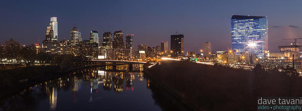 The sunsets over the Philadelphia skyline as seen from the Spring Garden Street Bridge on November 29, 2013.