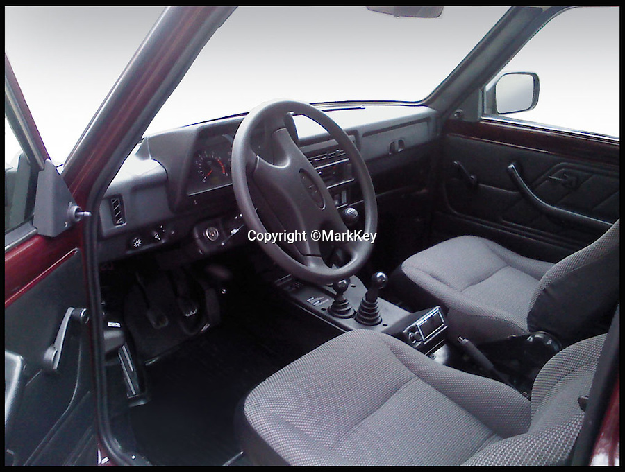 BNPS.co.uk (01202 558833)<br /> Pic: MarkKey/BNPS<br /> <br /> ***Please Use Full Byline***<br /> <br /> The driving seat of the Lada Niva 4 X 4. <br /> <br /> A Soviet relic that was once the laughing stock of British roads is set to become a surprise hit due to the demise of the iconic Land Rover Defender.<br /> <br /> With production of the classic British motor coming to an end this year, outdoor types are finding an unlikely replacement for the beloved model - the Lada Niva.<br /> <br /> The boxy Russian car was dubbed &quot;a skip on wheels&quot; when it was first unveiled alongside its even more mocked sister model the Riva in the late 1970s, and despite a cult following was pulled from production in 1997.<br /> <br /> But it is now winning over an army of new fans in rural areas across the country after canny dealer Mark Key brought it back to Britain for the first time in nearly 20 years.