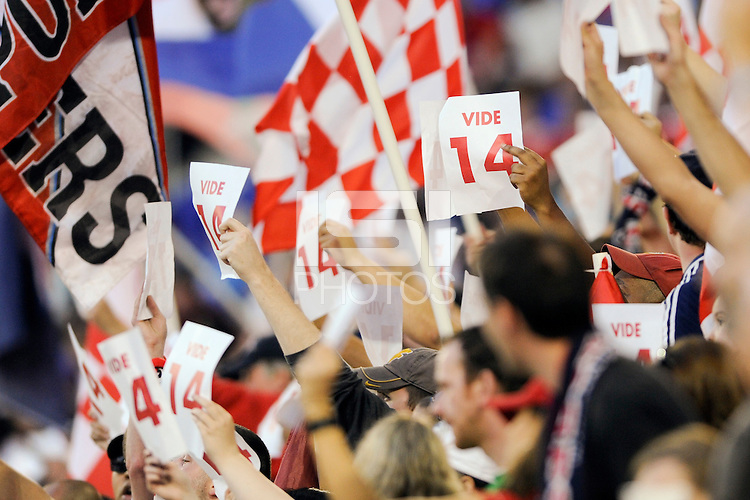 """New York Red Bulls fans hold up signs reading """"Vide 14"""" in honor of former New York Red Bulls player Joe Vide (not pictured) (2006-2007 number 14) who was recently diagnosed with stage 3 Hodgkin's Lymphoma during a Major League Soccer (MLS) match against the Seattle Sounders at Red Bull Arena in Harrison, NJ, on May 15, 2010."""
