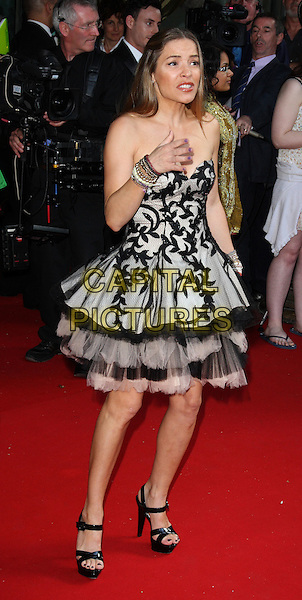 ELEN RIVAS .Royal Premiere of 'Arabia 3D' at the BFI Imax cinema, London, England, UK,.May 24th 2010.full length black strapless tulle layered layered tiered dress hand grey gray patterned pattern platform strappy sandals  .CAP/ROS.©Steve Ross/Capital Pictures.