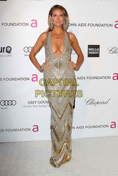 Heidi Klum (wearing Julien Macdonald).The 21st Annual Elton John AIDS Foundation Academy Awards Viewing Party held at The City of West Hollywood Park in West Hollywood, California, USA..February 24th, 2013.oscars full length gold diamante sequins sequined dress beads beaded art deco plunging neckline cleavage hands on hips.CAP/ADM/KB.©Kevan Brooks/AdMedia/Capital Pictures.