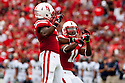 03 Sep 2011: Daimion Stafford #3 of the Nebraska Cornhuskers celebrates his hit on Chris Awuah #9 of the Chattanooga Mocs along with Andrew Green #11 at Memorial Stadium in Lincoln, Nebraska. Nebraska defeated Chattanooga 40 to 7.