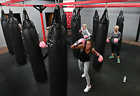 NWA Democrat-Gazette/J.T. WAMPLER Students work the bags during a kick-boxing class Wednersday Feb . 21, 2018 at Fayetteville Fitness Kickboxing.