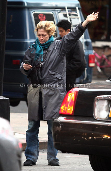 WWW.ACEPIXS.COM . . . . .  ....March 1 2012, New York City....Actress Edie Falco hails a cab on March 1 2012 in New York City....Please byline: CURTIS MEANS - ACE PICTURES.... *** ***..Ace Pictures, Inc:  ..Philip Vaughan (212) 243-8787 or (646) 769 0430..e-mail: info@acepixs.com..web: http://www.acepixs.com