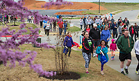 NWA Democrat-Gazette/BEN GOFF @NWABENGOFF<br /> Walkers make their way around the 1.5 mile course Saturday, April 13, 2019, during the Northwest Arkansas Heart Walk starting from the Walmart Arkansas Music Pavilion in Rogers. This year is the 25th anniversary for the American Heart Association's annual walk with locations around the country. This year's Northwest Arkansas walk raised more than $1 million with donations still coming in as of Saturday morning, said to Lauren Wheeler with the American Heart Association Northwest Arkansas.