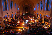 Hundreds of survivors of Typhoon Haiyan have dinner and rest under candle light in a church where they found shelter in Tacloban November 21, 2013. As millions of dollars pour in for more than four million left homeless by a typhoon in the central Philippines, authorities are grappling with a familiar problem - how to stop fraudulent claims and prevent greedy politicians taking advantage. Typhoon Haiyan smashed through the country on November 8, laying waste to just about everything in its path, and killing more than 4,000 people.