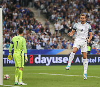 Harry Kane (Tottenham Hotspur) of England celebrates his 2nd goal past his club teammate Hugo Lloris (Tottenham Hotspur) of France during the International Friendly match between France and England at Stade de France, Paris, France on 13 June 2017. Photo by David Horn/PRiME Media Images.