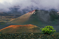 Colorfull cinder cones shrouded in an umbrella of clouds in HALEAKALA NATIONAL PARK on Maui in Hawaii