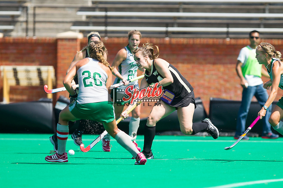 Holly Brown (24) of the Wake Forest Demon Deacons passes the ball during first half action against the William & Mary Tribe at Kentner Stadium on September 15, 2013 in Winston-Salem, North Carolina.  The Demon Deacons defeated the Tribe 4-0.  (Brian Westerholt/Sports On Film)