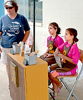 Janelle Jessen/Herald-Leader<br /> McKenna Baum, 11, center, and Jaelyn Baum, 9, sold Bark Bites at the Pool Pawty, a fundraiser for Tailwaggers, at the Siloam Springs Aquatic Center in September. The two sisters started the dog treat business and give 20 percent of their proceeds to Tailwaggers.