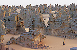 "Except some moufflons  hunters, Touaregs avoid passing in The Tassili of Maghidet natural fortress, nest of ""djenoun"" or evil geniuses. At dawn, you have to climb on a sandstone peak to discover this amazing rocky labyrinth streching on a pink sand crescent of 45 km long."