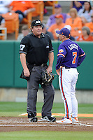 Clemson Tigers head coach Jack Leggett #7 has a discussion with home plate umpireScott Erby during a game against the Florida State Seminoles at Doug Kingsmore Stadium on March 22, 2014 in Clemson, South Carolina. The Seminoles defeated the Tigers 4-3. (Tony Farlow/Four Seam Images)