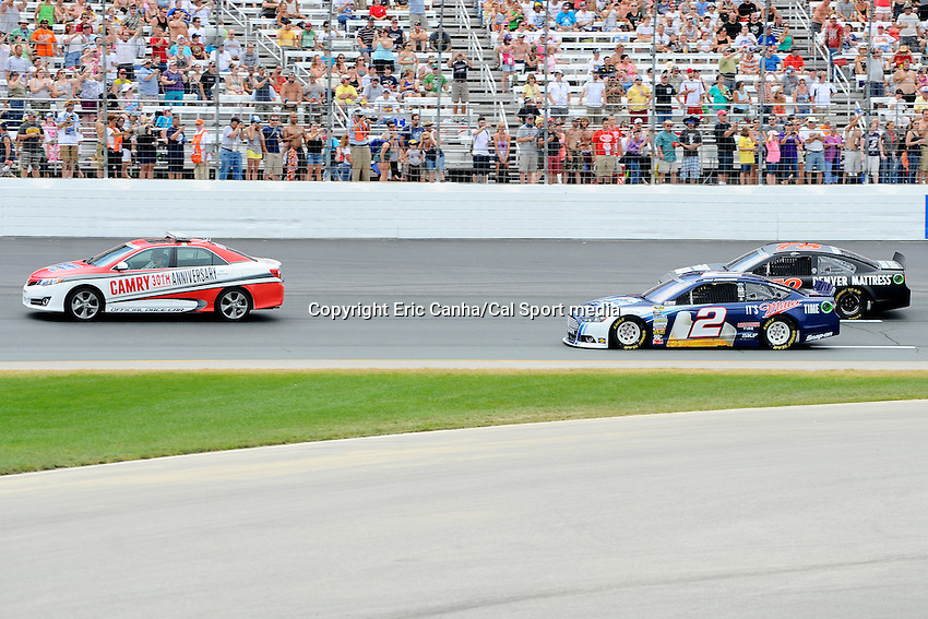 July 14, 2013 - Loudon, New Hampshire U.S. - Sprint Cup Series driver Brad Keselowski (2) and Sprint Cup Series driver Kurt Busch (78) are lead by the pace car into turn two during the NASCAR Sprint Cup Series Camping World RV Sales 301 held at the New Hampshire Motor Speedway in Loudon, New Hampshire.   Eric Canha/CSM