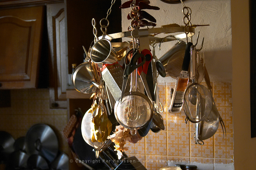 Kitchen utensils in stainless steel hanging on hooks in the Provence kitchen: grater, strainer, sieves, funnels, spoons, grinder... Clos des Iles Le Brusc Six Fours Cote d'Azur Var France