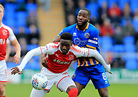 Devante Cole of Fleetwood Town battles Abu Ogogo of Shrewsbury Town during the Sky Bet League 1 match between Shrewsbury Town and Fleetwood Town at Greenhous Meadow, Shrewsbury, England on 21 October 2017. Photo by Leila Coker / PRiME Media Images.