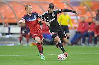 Washington, D.C.- March 29, 2014. Davy Arnaud (8) of D.C. United goes against Jeff Larentowicz of the Chicago Fire.  The Chicago Fire tied D.C. United 2-2 during a Major League Soccer Match for the 2014 season at RFK Stadium.