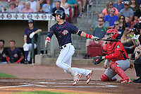 Cedar Rapids Kernels third baseman Jose Miranda (15) swings at a pitch against the Peoria Chiefs at Veterans Memorial Stadium on June 16, 2018 in Cedar Rapids, Iowa. The Kernels won 12-4.  (Dennis Hubbard/Four Seam Images)