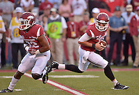 STAFF PHOTO BEN GOFF  @NWABenGoff -- 09/20/14 <br /> Arkansas quarterback Brandon Allen holds onto the ball after faking a handoff to running back Jonathan Williams during the first quarter of the game against Northern Illinois in Reynolds Razorback Stadium in Fayetteville on Saturday September 20, 2014.