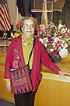 Award winner, Marian Wright Edelman poses nesxt to flowers at the John Jay Justice Award ceremony, April 5 2011.